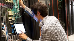 An IT worker checks on the server.