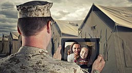A soldier abroad speaks with his family back home.