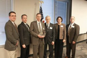 ISSITS team members receive the 2010 Small Business of the Year award.